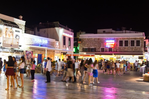 BODRUM, MUGLA, TURKEY - JULY 24, 2014: People in Bodrum bar street at night. Bodrum bar street is one of the most famous nightlife district in Turkey.